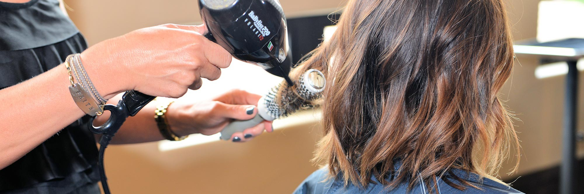 hair style services picture, hair being curled by hair dresser.
