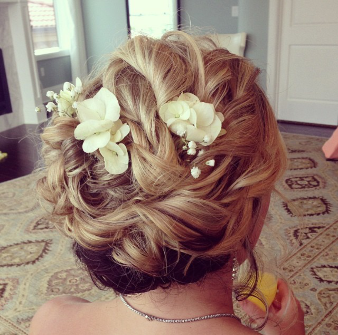 We'll help you take his breath away with a stunning updo and fresh flowers.