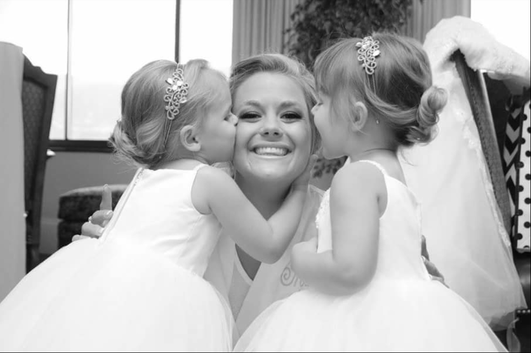 Gleeful kisses for the beautiful bride.