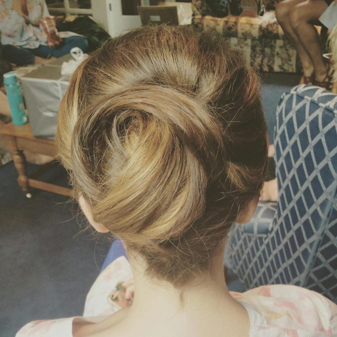 Updos can highlight the subtle colors of beautiful hair.